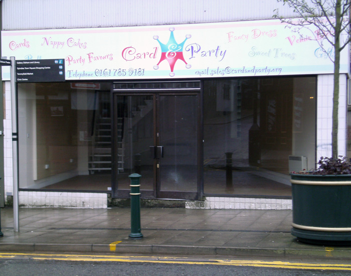 closed independent quarter shop with smashed glass door